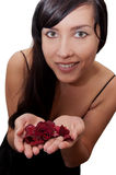 Beautiful brunette woman holding red rose Royalty Free Stock Photography
