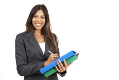 Beautiful brunette woman holding some files Royalty Free Stock Photos
