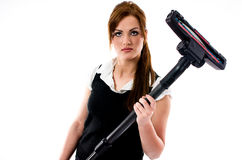 Beautiful brunette woman holding a vacuum cleaner Royalty Free Stock Images