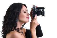 Beautiful brunette  woman holding a vintage camera isolated Royalty Free Stock Photos