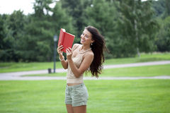 beautiful brunette woman and holds book Stock Photography