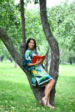 Beautiful brunette woman and holds book Stock Images