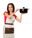 Beautiful brunette woman housewife holding pan Stock Images