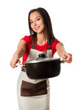 Beautiful brunette woman housewife holding pan Royalty Free Stock Photography