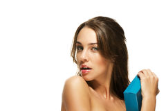 Beautiful brunette woman hugs present Stock Photography