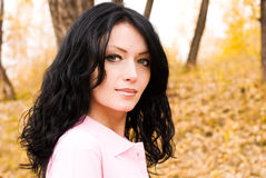 Beautiful Brunette Woman In The Park Stock Photo