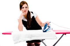 Beautiful brunette woman irons clothes Royalty Free Stock Image