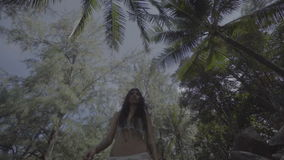 Beautiful brunette woman in the jungle stock video footage