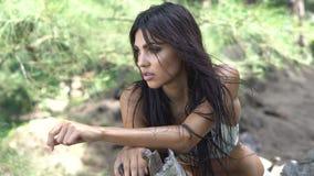 Beautiful brunette woman in the jungle stock video