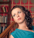 Beautiful brunette woman in the library. old style photo Stock Photography