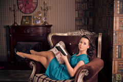 Beautiful brunette woman in the library. old style photo Stock Photos