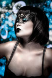 Beautiful brunette woman in lingerie with Venetian mask in a nig Stock Image