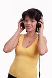 Beautiful brunette woman is listen to the music at headphones Royalty Free Stock Images