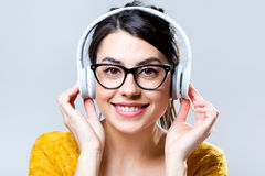 Beautiful brunette woman listening to music Stock Images
