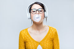 Beautiful brunette woman listening to music Royalty Free Stock Photos