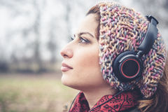 Beautiful brunette woman listening to music with headphones Royalty Free Stock Photo
