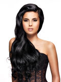 Beautiful brunette woman with long black  hair Royalty Free Stock Image