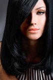 Beautiful brunette woman with long black straight hair Royalty Free Stock Photos