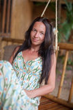 Beautiful brunette woman in long dress relaxing in Royalty Free Stock Photo