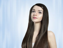 Beautiful brunette woman with long shiny hair. Beautiful young brunette woman with long dark shiny hair stock photo