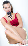Beautiful brunette woman looking the mobile Royalty Free Stock Photos