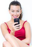 Beautiful brunette woman looking the mobile. Brunette woman looking the mobile Royalty Free Stock Images