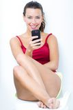 Beautiful brunette woman looking the mobile. Brunette woman looking the mobile Stock Images