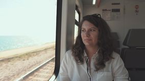 Woman riding on train in summer. stock video footage