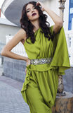 Beautiful brunette woman in luxurious green dress Royalty Free Stock Photo