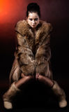 Woman in luxury winter fur coat Stock Photo