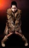 Woman in luxury winter fur coat Stock Photo