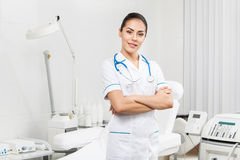 Beautiful brunette woman medical worker. Young nurse - beautiful brunette woman medical worker indoors stock photography