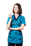 Beautiful brunette woman medical worker. Young nurse - beautiful brunette woman medical worker with stethoscope isolated on white holding electronic thermometer royalty free stock image