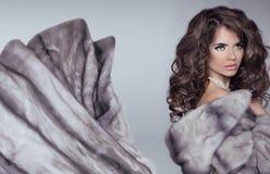Beautiful brunette woman in mink fur coat. Fashion Beauty girl m Stock Photo