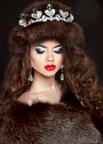 Beautiful brunette woman in mink fur coat. Jewelry. Fashion Beau Stock Photography