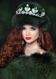 Beautiful brunette woman in mink fur coat. Jewelry. Fashion Beau Stock Image
