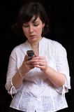 Beautiful brunette woman with mobile. Beautiful brunette woman on black background with mobile Stock Images
