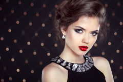 Beautiful brunette woman model with makeup and hairstyle in fash Stock Images