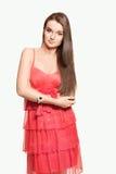 Beautiful brunette woman model posing in red dress Stock Image