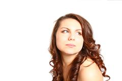 Beautiful brunette woman with naked shoulder looking to the side Royalty Free Stock Photos