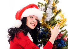 Beautiful brunette woman near the Christmas tree. Beautiful smiling brunette woman standing near the Christmas tree Stock Photos