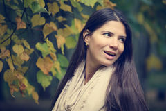 Beautiful brunette woman outdoors. Beautiful brunette woman portrait on autumn tree background Stock Photos