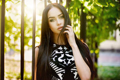 Beautiful brunette woman outdoors portrait on a sunny day.  Royalty Free Stock Photography