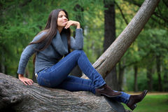 Beautiful brunette woman outdoors Stock Images