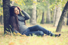 Beautiful brunette woman outdoors Stock Photography