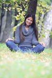 Beautiful brunette woman outdoors Stock Image