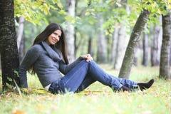 Beautiful brunette woman outdoors Stock Photo