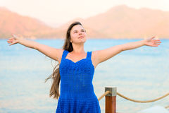 Beautiful brunette woman. With outstretched hands Royalty Free Stock Photography