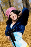 Beautiful brunette woman in the park. Beautiful happy brunette woman in the park Royalty Free Stock Photography
