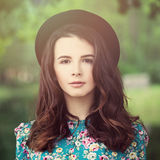 Beautiful Brunette Woman in Park. Girl in a Hat Outdoors Stock Photography